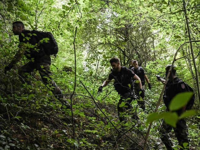 French gendarmes search through a forest in Pont-de-Beauvoisin on August 30, 2017 after the disappearance of a 9-year-old girl. Picture: AFP.
