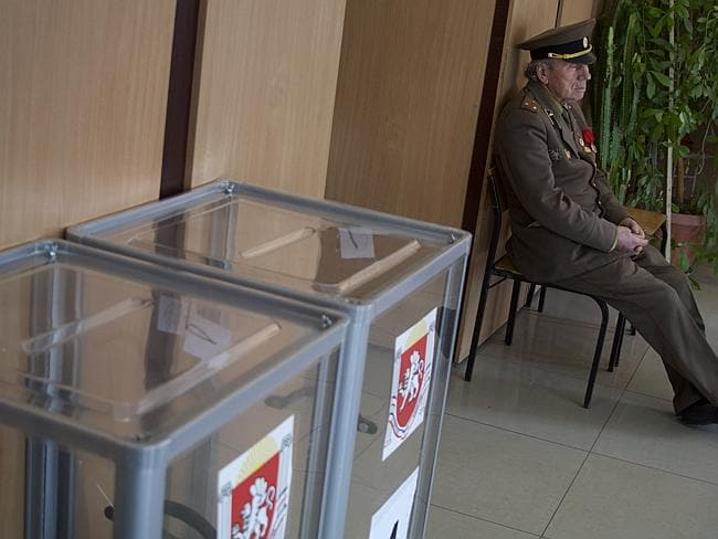 Clear victory ... An election observer sits at a polling station in Simferopol, Ukraine. Picture: Ivan Sekretarev