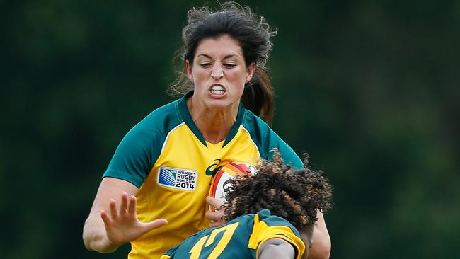Natasha Haines of Australia is tackled by Lorinda Brown of South Africa during the IRB Women's Rugby World Cup Pool C match.