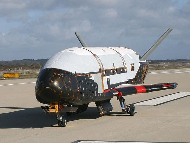 Robot school ... the X-37B Orbital Test Vehicle undergoes testing at the Astrotech facility in Titusville, Florida, in 2010.