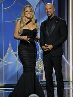 Mariah Carey and Common speak onstage during the 75th Annual Golden Globe Awards at The Beverly Hilton Hotel on January 7, 2018 in Beverly Hills, California. Picture: Getty