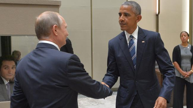 Russian President Vladimir Putin shakes hands with his US counterpart Barack Obama. Picture: AFP