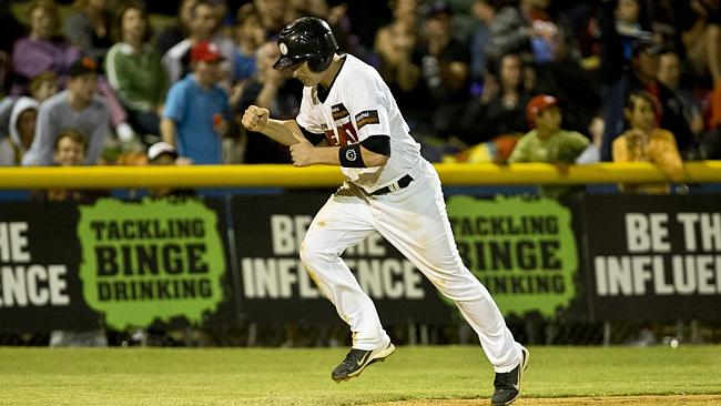 Matt Kennelly pumps his fists as he makes his way to home base, to put Perth Heat 2 innings up in their grand final match. Pi...