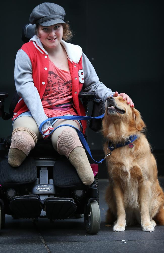 Sophie Delezio with her dog Willow at the Assistance dogs Australia graduation ceremony in Martin Place. Picture: Adam Taylor