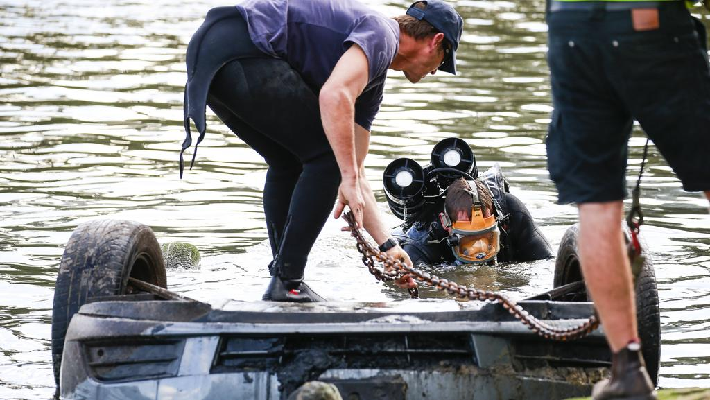 Police divers search and recover a vehicle. Three Sydney men have been accused of submitting more than $1m worth of fraudulent third party compensation claims. Picture: Dylan Robinson