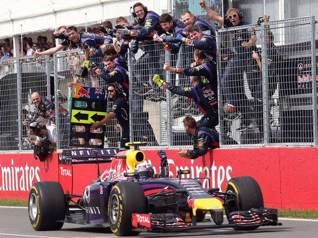 Ricciardo passes his pit crew on his way to winning the Canadian Grand Prix.