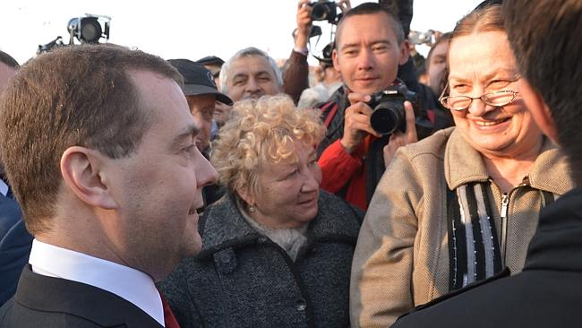 Warm welcome ... Mr Medvedev speaks to local citizens after a wreath laying ceremony at the World War II memorial in Sevastopol. Picture: Ria Novosti / Dmitry Astakhov / Government Press Service)