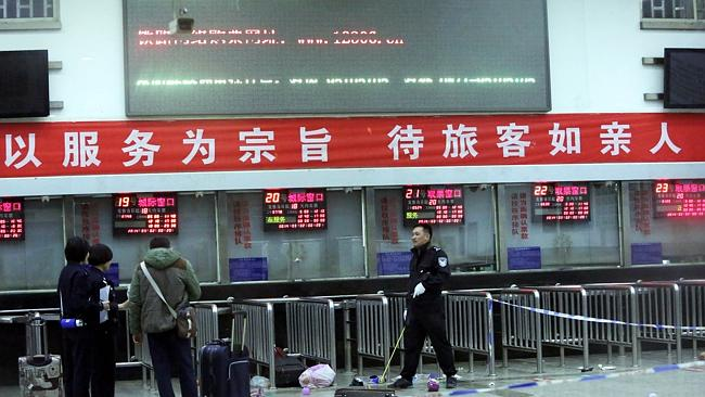 Chinese police investigators inspect the scene of an attack at the railway station in Kunming, southwest China's Yunnan province. Picture: AFP
