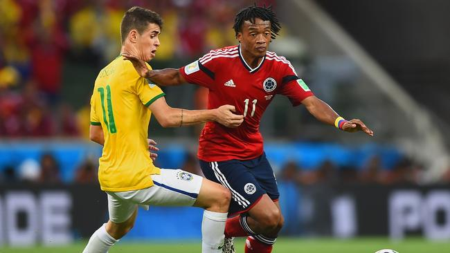 Oscar of Brazil and Juan Cuadrado of Colombia - a transfer target of United and Barcelona.