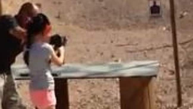 Unimaginable tragedy ... Charles Vacca shows the girl how to fire an Uzi. Seconds later he was shot in the head.