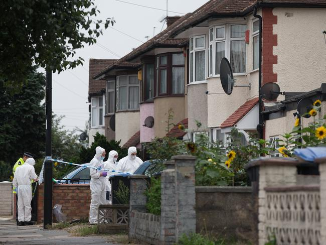 Scene of the crime ... forensic experts examine the property. Picture: Oli Scarff/Getty Images