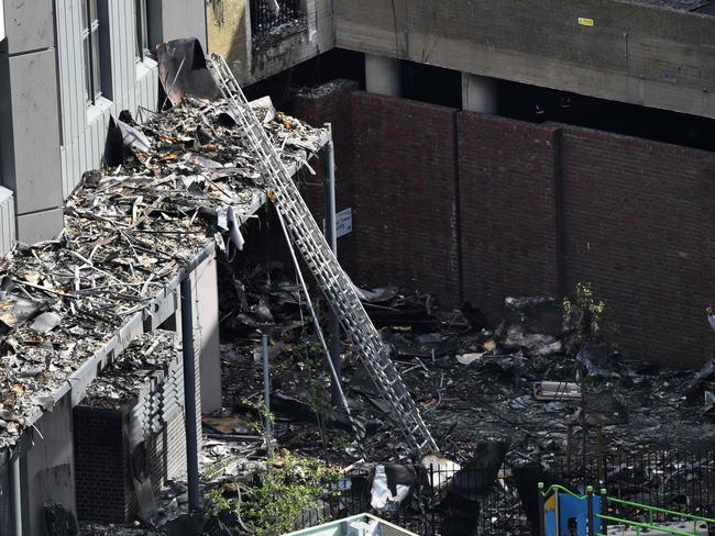 Firemen inspect the remains of Grenfell Tower. Picture: AFP