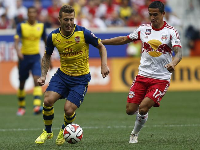 Tim Cahill takes on Jack Wilshere in a recent friendly against Arsenal.