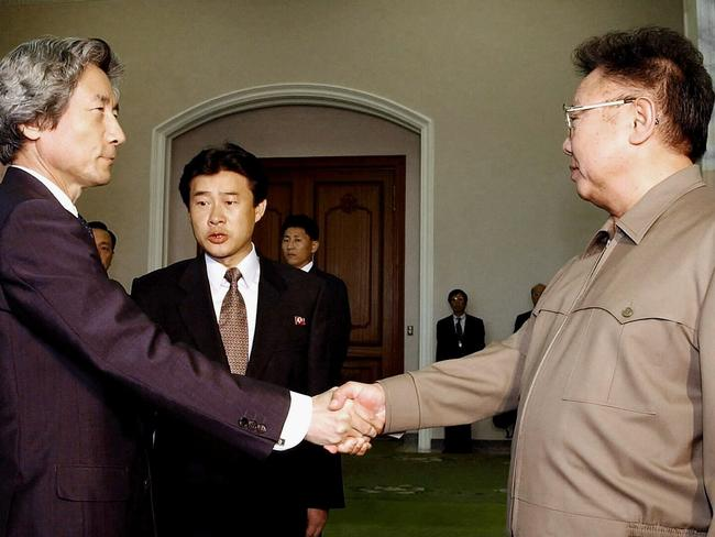 Historic meeting ... Japanese PM Junichiro Koizumi (L) shaking hands with North Korean leader Kim Jong-Il in Pyongyang. Picture: Supplied.