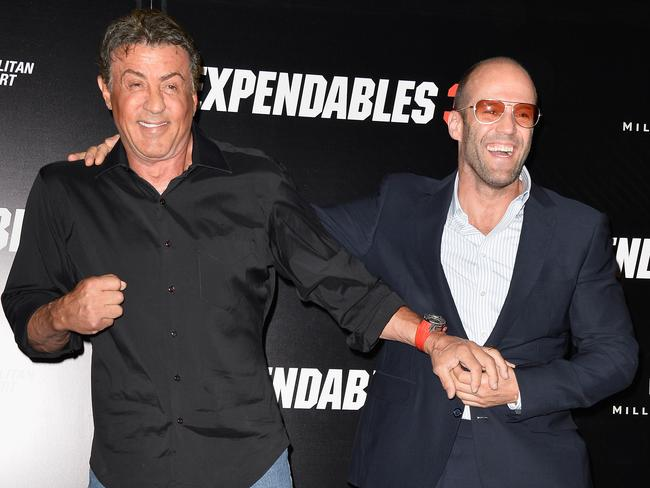 Stallone and Jason share a laugh as they face the media in Paris. Picture: Getty