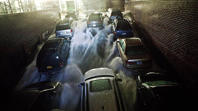 Rising water, caused by Hurricane Sandy, rushes into a subterranian parking garage in the Financial District of New York. Picture: Andrew Burton/Getty Images/AFP