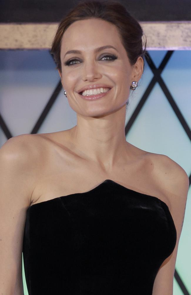 "Angelina Jolie smiles as she poses for photographers during the Japan premiere of ""Maleficent"" in Tokyo Monday, June 23, 2014. (AP Photo/Shizuo Kambayashi)"