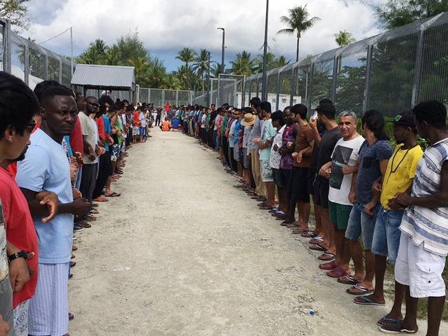Refugees at Manus Island detention centre linked hands in solidarity ahead of the centre's closure. Picture: AAP