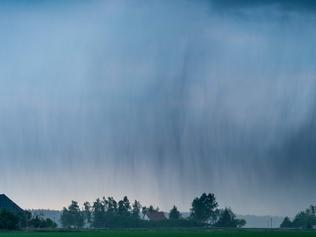 A thunder cell bringing heavy rain and hail hangs over a field near Neuhardenberg, northeastern Germany, on May 24, 2016. / AFP PHOTO / dpa / Patrick Pleul / Germany OUT