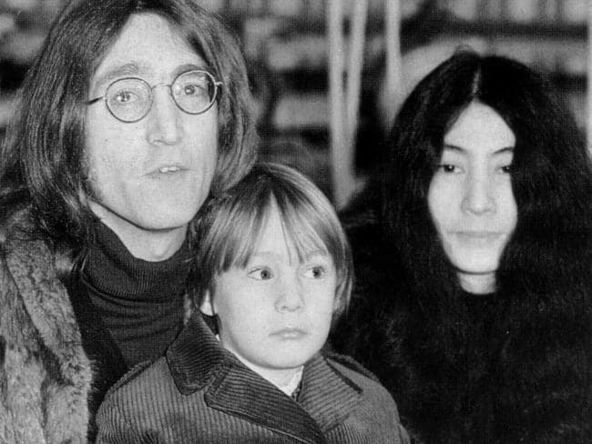 Killed outside his home ... John Lennon with son Julian and Yoko Ono in 1968.