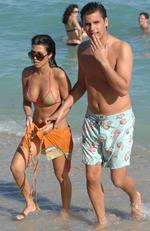 Kourtney Kardashian and boyfriend Scott Disick walk on South Beach on December 31, 2007 in Miami. Picture: Getty