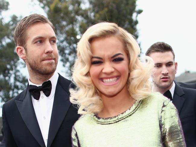 Still smiling ... Rita Ora (R) and Calvin Harris attend the 56th GRAMMY Awards in January.