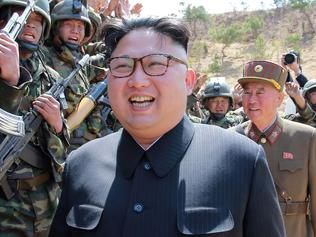 "TOPSHOT - This undated picture released from North Korea's official Korean Central News Agency (KCNA) on April 14, 2017 shows North Korean leader Kim Jong-Un (C) inspecting the ""Dropping and Target-striking Contest of KPA Special Operation Forces - 2017"" at an undisclosed location in North Korea. North Korean leader Kim Jong-Un has overseen a special forces commando operation, state media said on April 13, as tensions soar with Washington over Pyongyang's nuclear programme. / AFP PHOTO / KCNA VIA KNS / STR / South Korea OUT / REPUBLIC OF KOREA OUT ---EDITORS NOTE--- RESTRICTED TO EDITORIAL USE - MANDATORY CREDIT ""AFP PHOTO/KCNA VIA KNS"" - NO MARKETING NO ADVERTISING CAMPAIGNS - DISTRIBUTED AS A SERVICE TO CLIENTS THIS PICTURE WAS MADE AVAILABLE BY A THIRD PARTY. AFP CAN NOT INDEPENDENTLY VERIFY THE AUTHENTICITY, LOCATION, DATE AND CONTENT OF THIS IMAGE. THIS PHOTO IS DISTRIBUTED EXACTLY AS RECEIVED BY AFP. /"