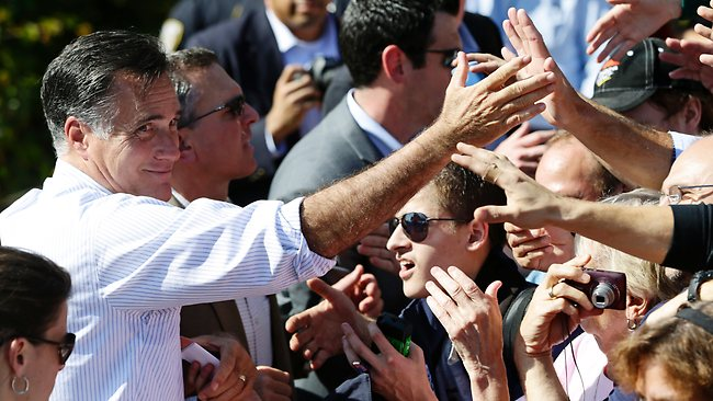Republican presidential candidate Mitt Romney greets supporters during a campaign stop at Tidewater Community College in Chesapeake, Virginia.