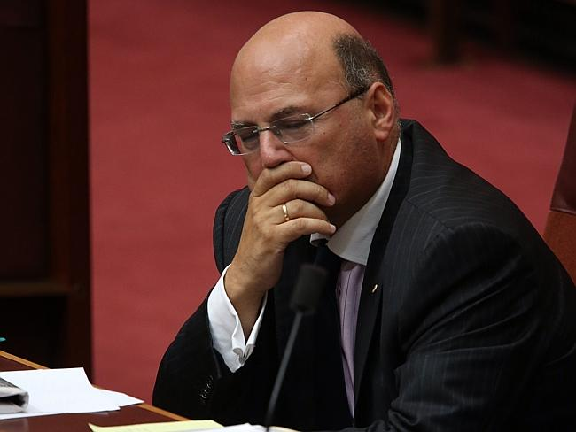 Stands aside ... Assistant Treasurer Senator Arthur Sinodinos said he will return after t