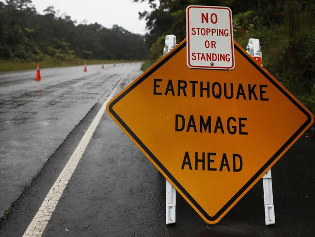 A sign is posted warning of earthquake damage to the road from seismic activity at the Kilauea volcano on Hawaii's Big Island. Picture: Mario Tama/Getty Images/AFP