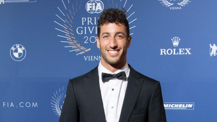 Red Bull Racing's Australian driver Daniel Ricciardo arrives for the FIA Prize Giving Gala at the Hofburg palace in Vienna, Austria on December 2, 2016. Nico Rosberg abruptly quit Formula One, just five days after winning his first world title, leaving motor racing stunned and Mercedes looking for a new teammate for Lewis Hamilton. / AFP PHOTO / JOE KLAMAR