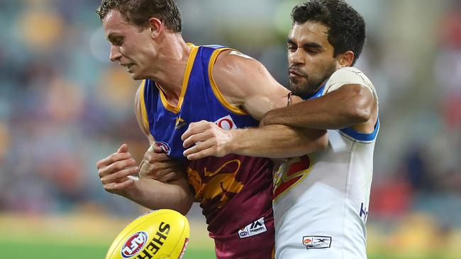 Brisbane's Ryan Lester is tackled by Jack Martin. Picture: Getty Images