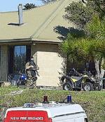 <p>NSW Police and Fire Brigade officers, some wearing protective clothing and breathing apparatus remove evidence from the house in Kelly Street, Bingie. near Batemans Bay. The dwelling is the alleged site of a large drug lab operation. Photo: Jon Poyner</p>