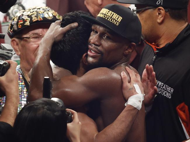 Floyd Mayweather embraces Manny Pacquiao after the fight.