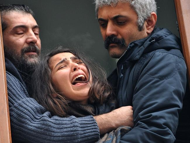 Grieg...Berkin Elvan's sister cries as his coffin is carried through the crowd during his funeral in Istanbul. Picture: AFP