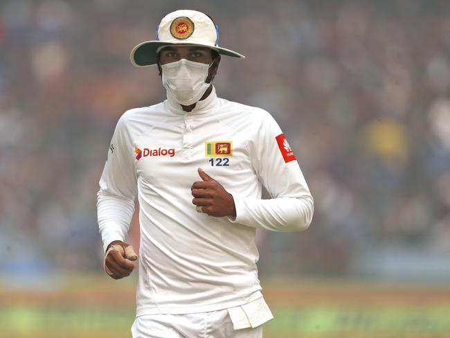 Sri Lanka's captain Dinesh Chandimal fields wearing an anti-pollution mask during the second day of their third test cricket match against India in New Delhi last week. Picture: Altaf Qadri