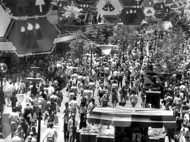 A crowded Rundle Mall is open for its first Christmas shopping in 1976.