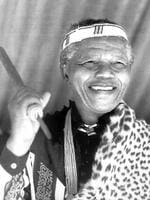 PIRATE: ANC president Nelson Mandela in traditional dress at election rally. Pic AFP 18/04/94. Alone Historical