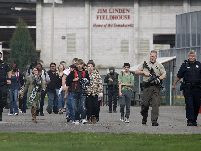 Students are evacuated and police remain on guard following the shooting.