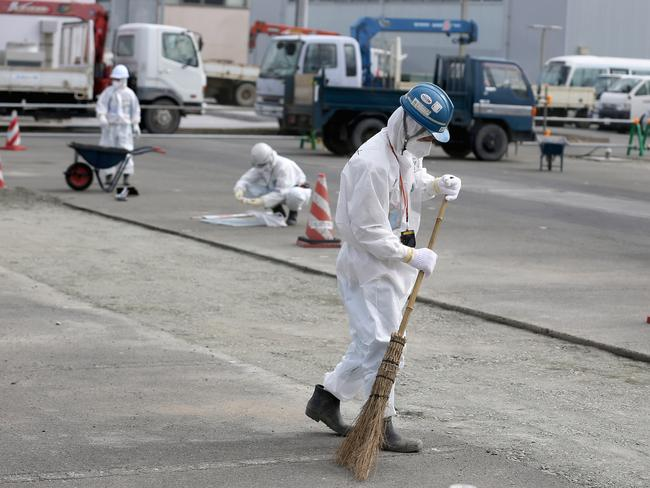 A worker sweeps up at Fukushima Daiichi nuclear power plant. Picture: Getty