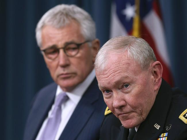 Officials ... Secretary of Defense Chuck Hagel (left) and Chairman of the Joint Chiefs of Staff General Martin Dempsey speak at the Pentagon. Picture: Getty Images/AFP