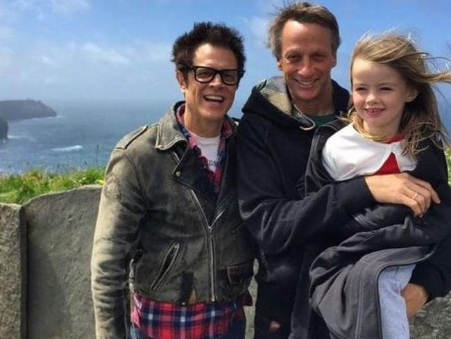 Hawk with his daughter and Johnny Knoxville.