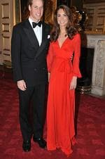 <p>Duchess of Cambridge at a fundraising Gala in a kimono-style red gown, with husband William. Photo: Theodore Wood, Getty Images</p>