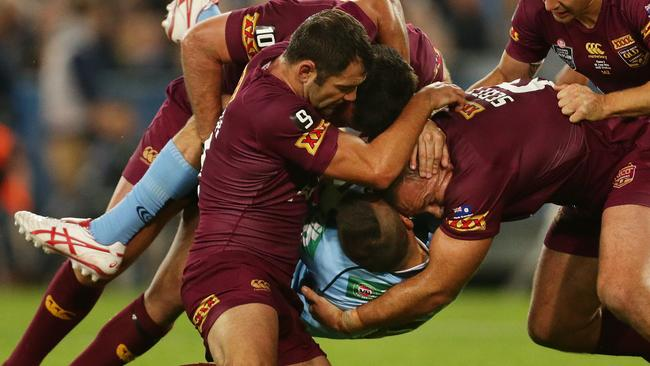 NSW playmaker Josh Reynolds is tackled.