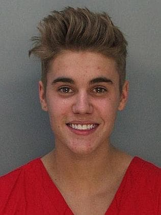 Bieber smiles for his close-up at the Miami-Dade Police Department.