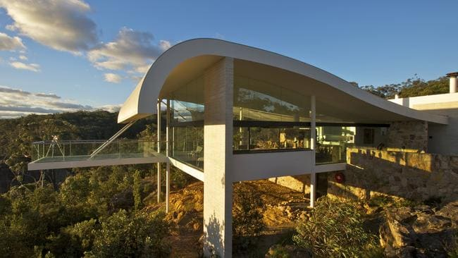 The Harry Seidler House in the Blue Mountains is so architecturally amazing you'll want to leave it just so you can gaze back in wonder. Picture: Contemporary Hotels.