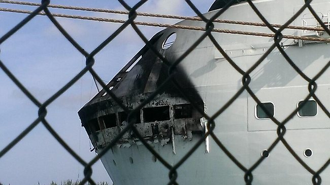 This photo provided by Royal Caribbean shows the fire-damaged exterior of Royal Caribbean's Grandeur of the Seas. Picture: AP