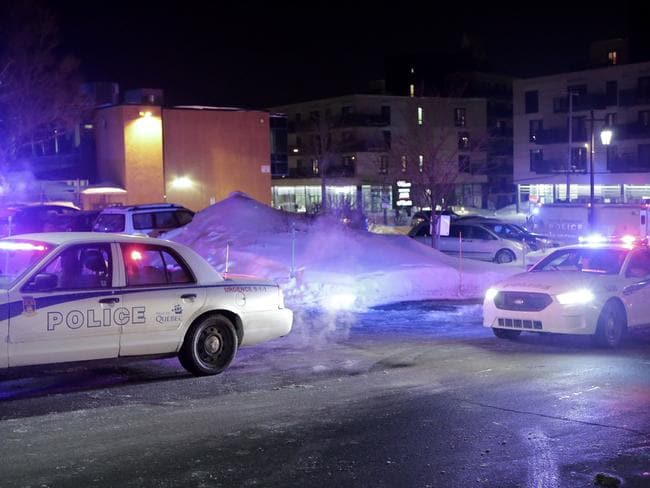 Police survey the scene after deadly shooting at a mosque in Quebec City, Canada. Picture: Francis Vachon/The Canadian Press via AP