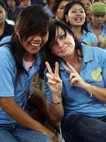 2008 - Schapelle Corby is all smiles with fellow inmate as they watch Olympic Games competition during a pre-Independence Day fun and games event at Kerobokan Jail in Denpasar, Bali. Picture: Supplied
