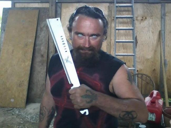 "Note the ""devil"" tattoos ... Accused killer Gregory Scott Hale with a long blade. Picture: Facebook"